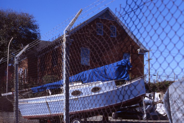 Sailboat locked behind a fence in the Northside, shot on Kodak's new Ektachrome E100 slide film.
