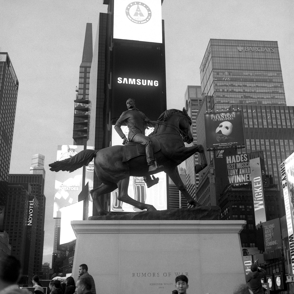 "Kehinde Wiley's monumental statue, ""Rumors of War"" standing in its temporary Times Square location"