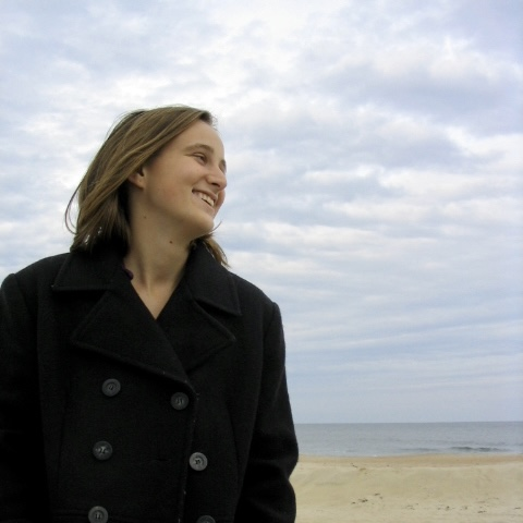 Valerie standing in front of Sea Girt Beach wearing a pea coat