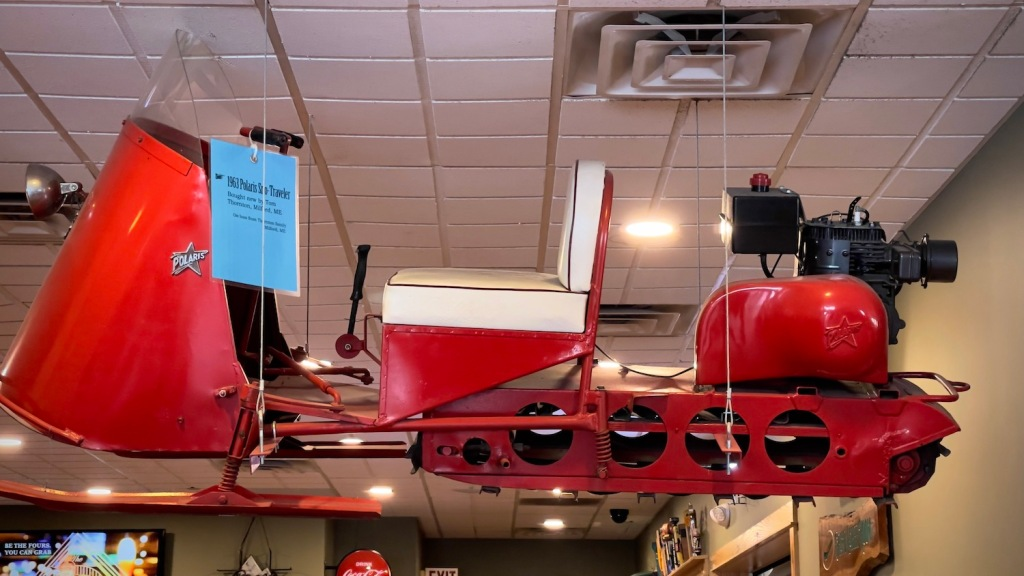 Vintage snowmobile handing from the ceiling in Dysart's restaurant in Bangor, Maine.