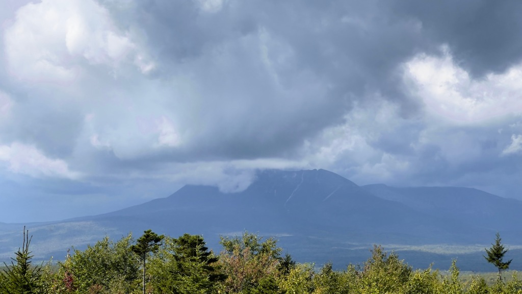 Katahdin in the distance with its peak in the clouds
