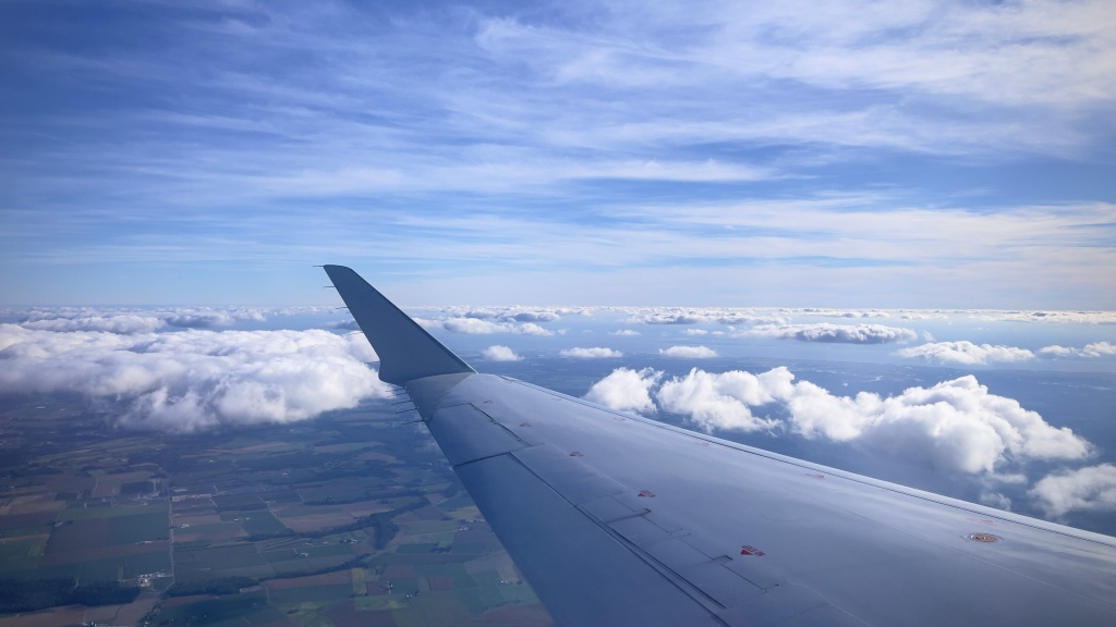 The starbord wing of the plane taking me from Bamgor to Philadelphia with the earth 30,000 feet below