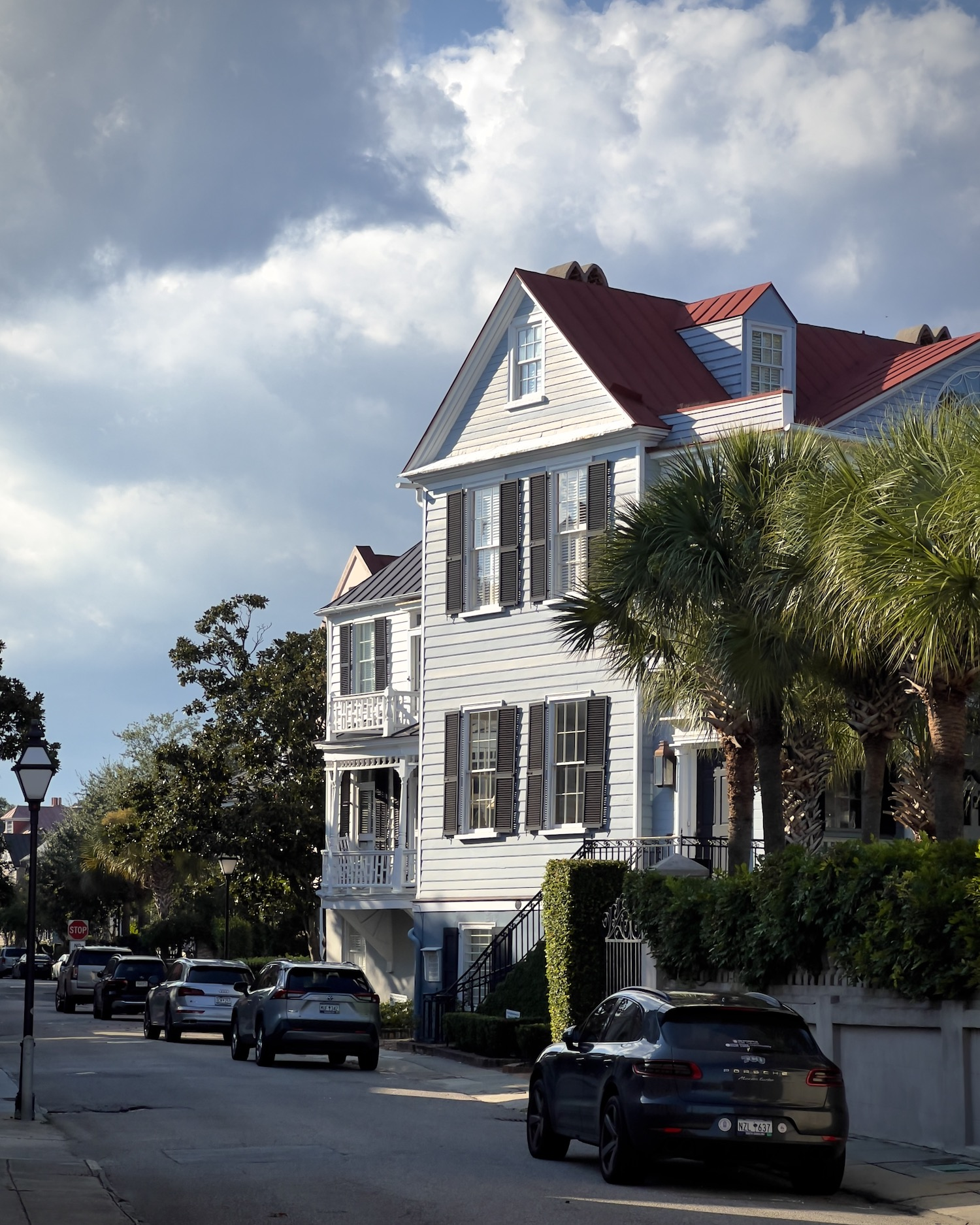 Just a random old house in Charleston, SC with some cool sunlight hitting its facade and dramatic clouds in the sky