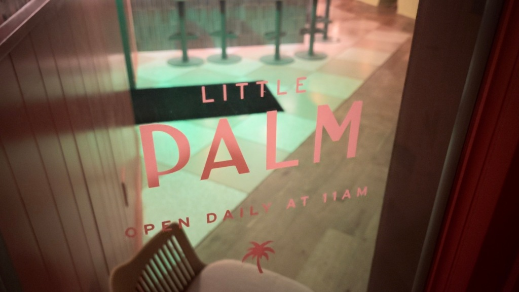 Entryway to Little Palm bar in Charleston, SC