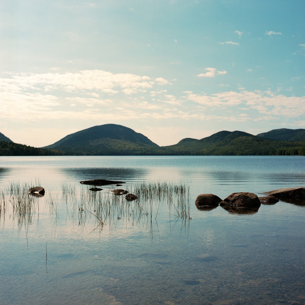 The Bubbles mountain peaks as viewed across Eagle Lake in Acadia National Park, ME.